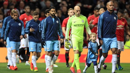 Manchester-City's-Vincent-Kompany-leads-the-team-out
