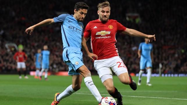 Jesus Navas battles for the ball with Luke Shaw