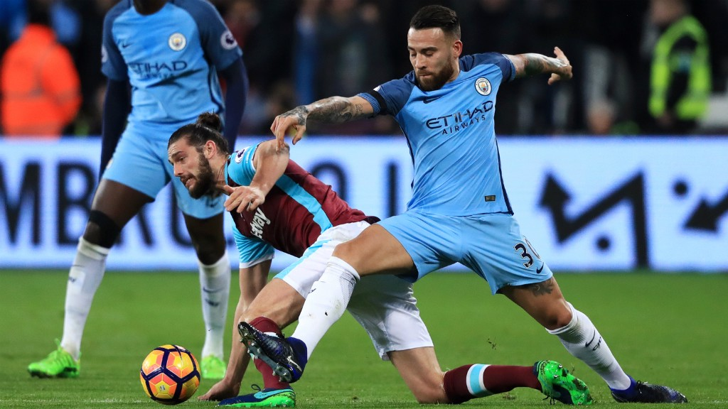 CHALLENGE: Nicolas Otamendi does well to dispossess Andy Carroll