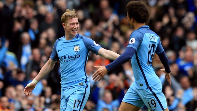 ALL WRAPPED UP: De Bruyne celebrates scoring City's third of the afternoon with Sane.