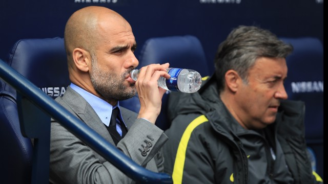 TAKING A BREATHER: Pep grabs a drink in the dugout after a  lightning start from his players