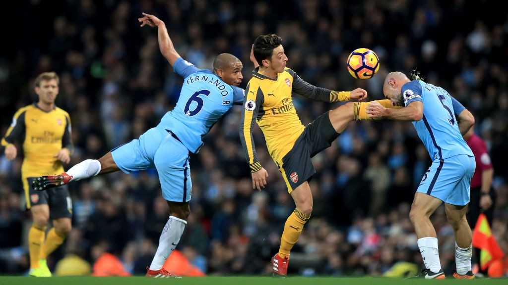 THICK OF THE ACTION: Fernando and Pablo Zabaleta get stuck in