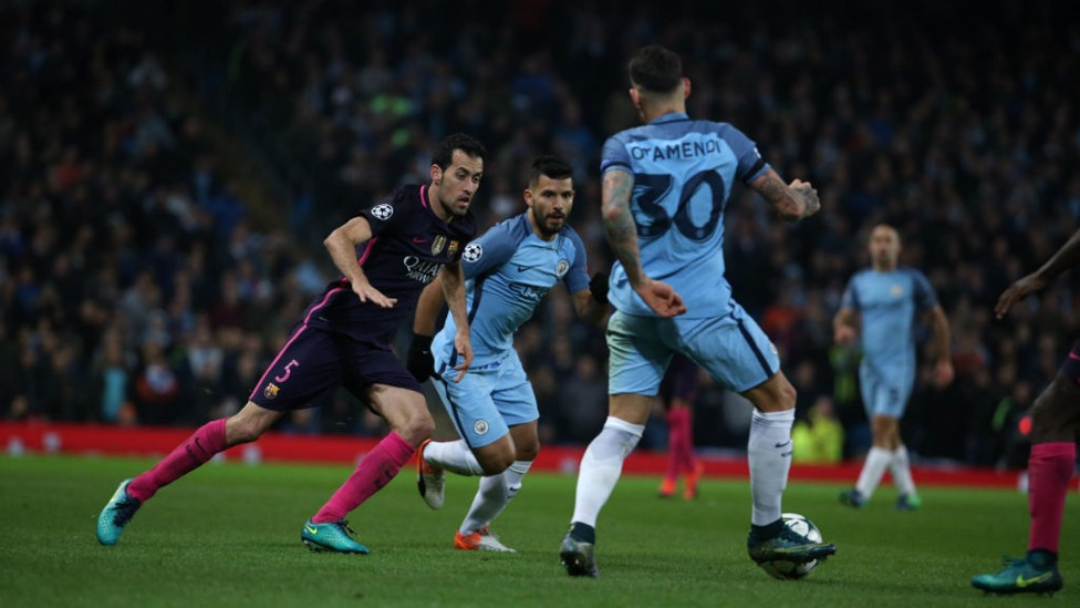 LINK UP: Otamendi and Aguero search for a way around Barcelona