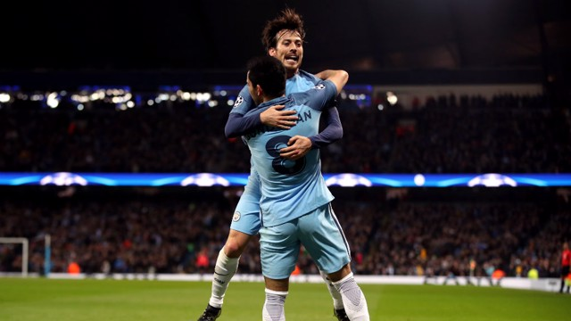 JUMP FOR JOY: Silva and Gundogan embrace after the German's strike