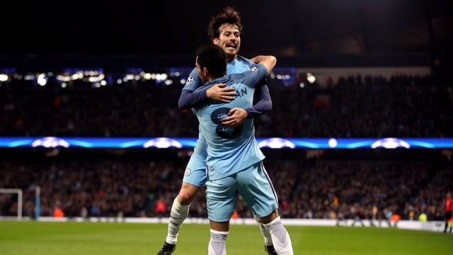 JUMP FOR JOY: Silva and Gundogan embrace after the German's strike