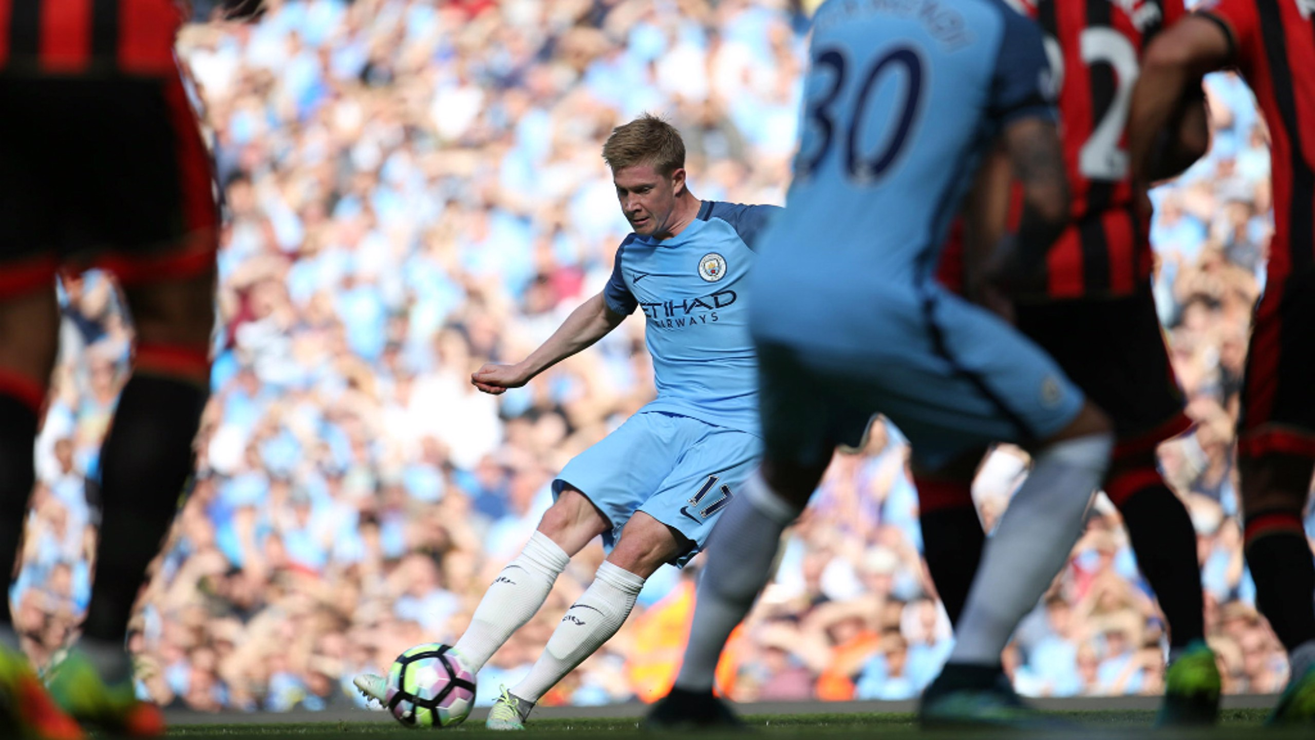 GOAL!: KDB slides a free kick under the Bournemouth wall to give the Blues an early lead.
