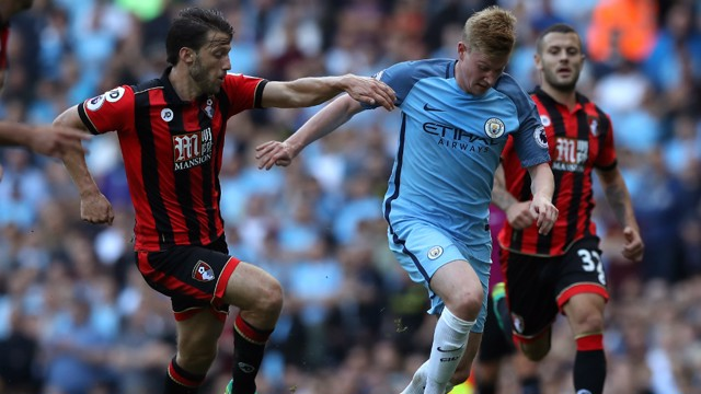 YOU CAN'T STOP ME: Harry Arter attempts to dispossess KDB as the Belgian midfielder storms past him.