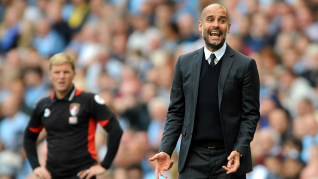 GUARDIOLA: The City boss watches on in the second half at the Etihad Stadium.