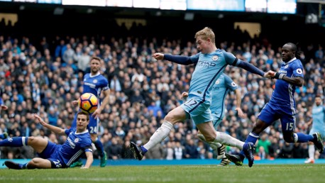 SO CLOSE: Kevin De Bruyne's close range effort heads towards the bar