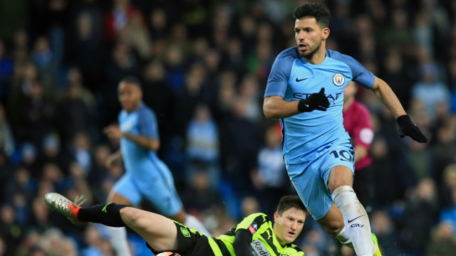 SEE YOU LATER: Aguero leaves Joe Lolley in his wake in the second half.