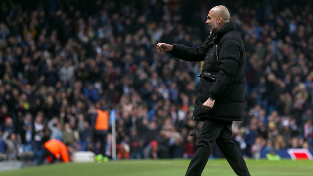 FIST PUMP: Pep celebrates City's third goal of the evening.