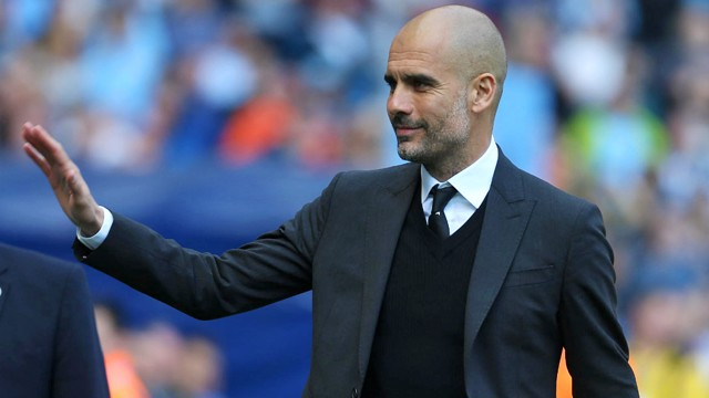 FAN WAVE: Pep acknowledges the supporters as he makes his way to the dugouts.