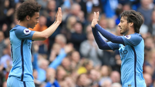 HIGH FIVE: Sane and David Silva celebrate the latter's goal.
