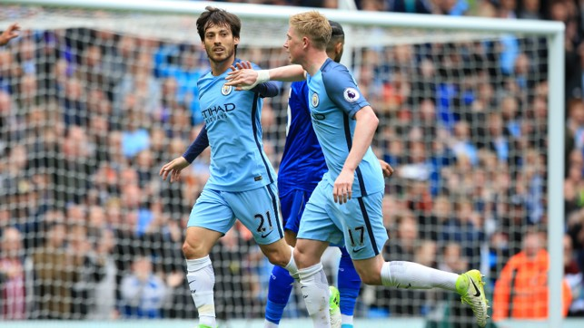 MIDFIELD MAGIC: David Silva and KDB start the celebrations for the opening goal of the game.
