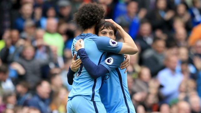 LEFT FOOTED WIZARDS: Sane and David Silva embrace after the opening goal.
