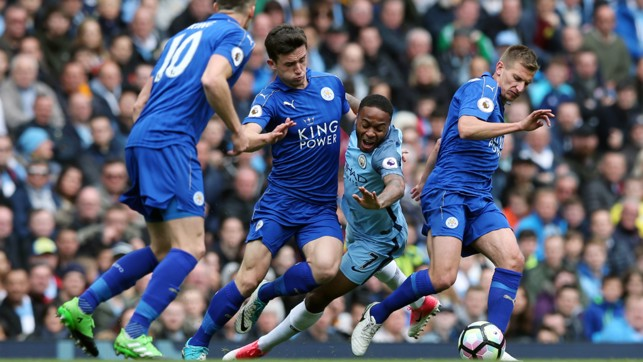 STERLING SANDWICH: Raheem is trapped between two Leicester players as Andy King looks on.