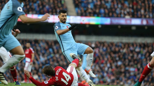 DETERMINED: Aguero fires an effort at goal but he can't beat Valdes