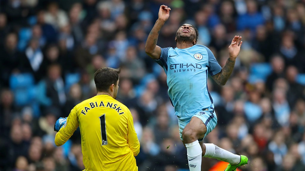 BOOKED: Sterling saw yellow for trying to evade Fabiański's trailing leg