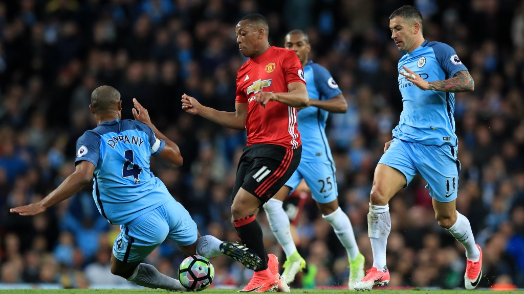 SOLID CHALLENGE: The skipper wins the ball from Anthony Martial with a well-timed tackle.