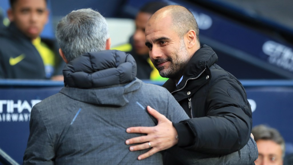 MANAGERS MEETING: Pep greets Jose Mourinho prior to kick off.