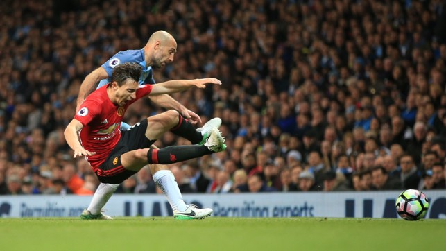 OPPOSITE NUMBERS: Pablo Zabaleta tackles Darmian as the two full backs collide.