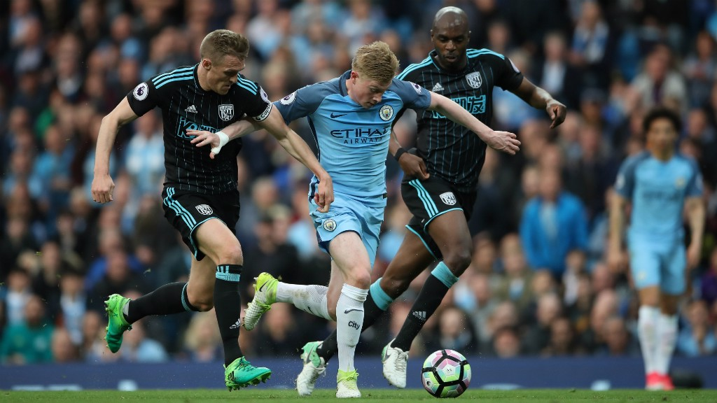 STRENGTH: Kevin De Bruyne outmuscles two opponents in a sparkling display by the Belgian