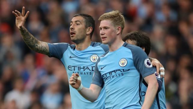 DOUBLED: Aleks Kolarov congratulates Kevin De Bruyne on extending City's lead