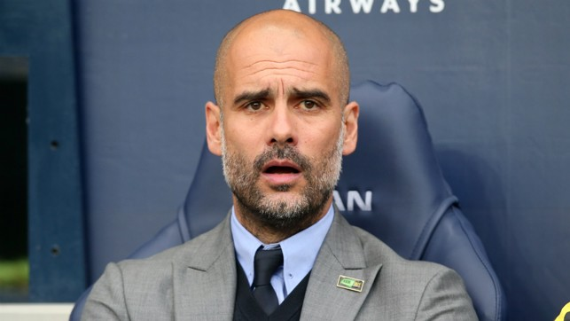 CLOSE UP: Pep Guardiola watches on intently