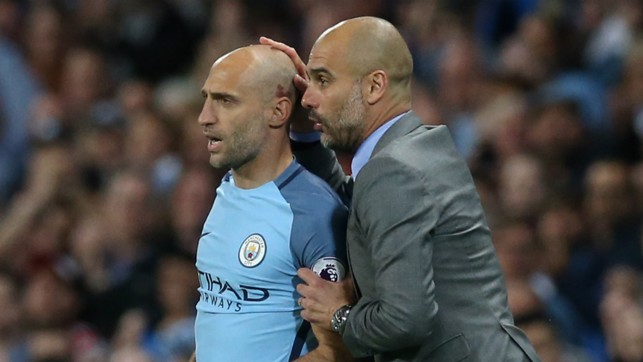 LEGEND: Pep Guardiola gives Pablo Zabaleta some encouraging words as he's about to come on