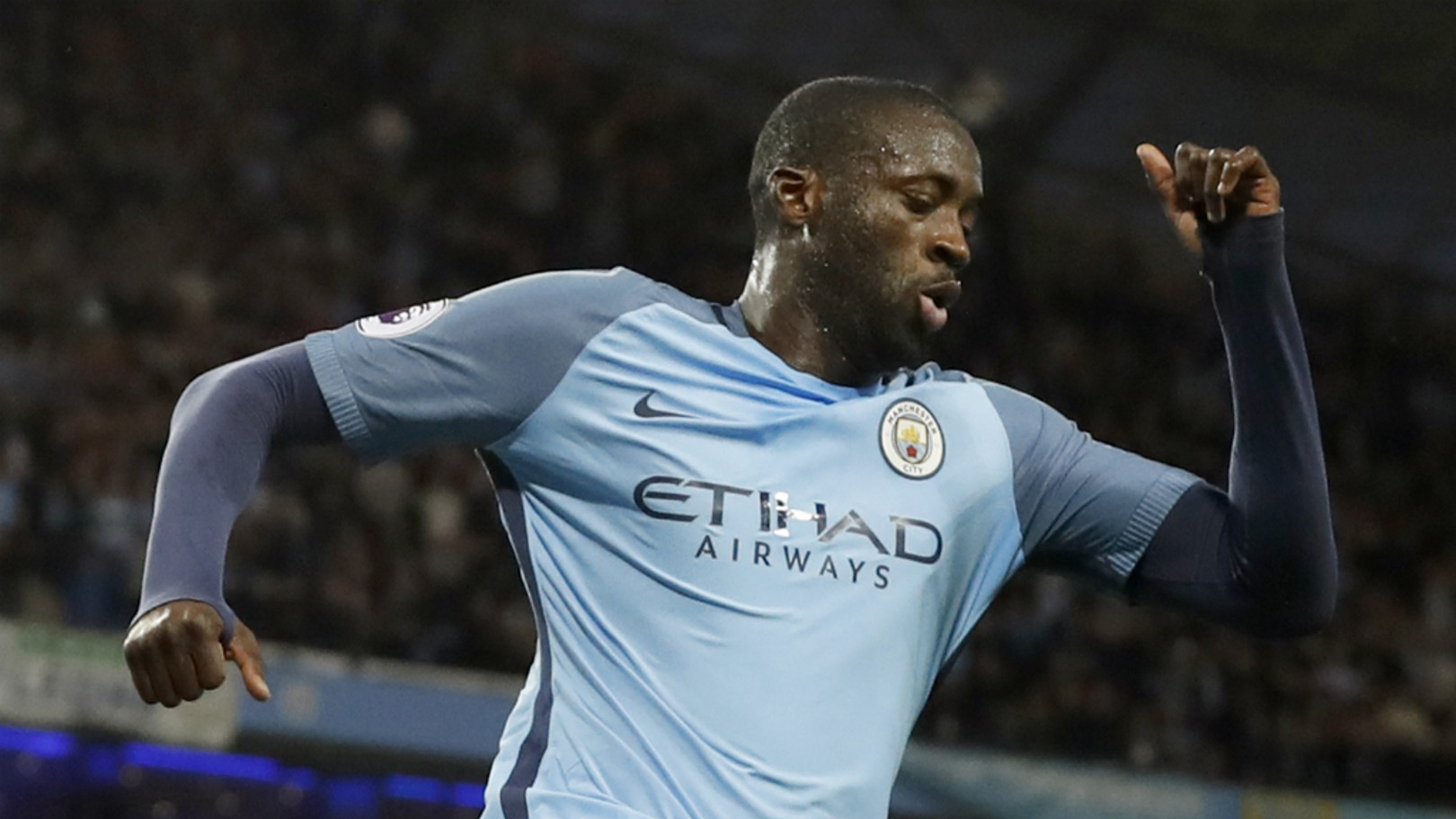 ELATION: Yaya Toure jumps for joy, following his cool finish for City's third