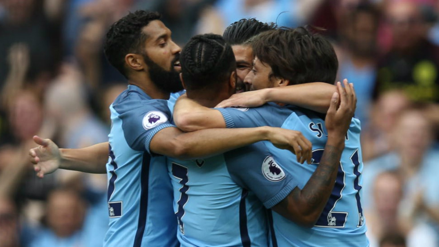 JOYOUS: The team celebrate Raheem Sterling's opener in front of the City fans