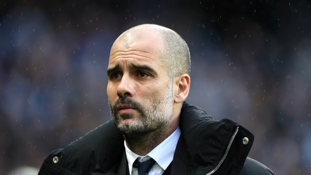 BRAVING THE COLD: Pep dons the jacket to battle the Manchester weather.
