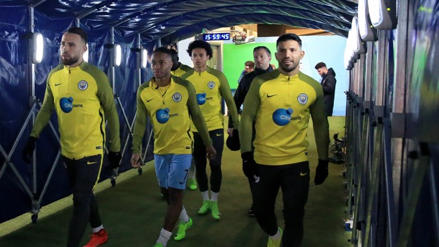 PREPARED: players head out for pre-match warm up