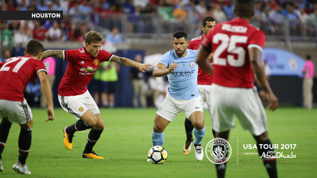 A CITY UNITED: Aguero takes on the United defence