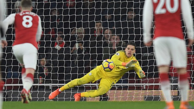 ​SAFE HANDS: Ederson denies Pierre-Emerick Aubameyang from the spot.