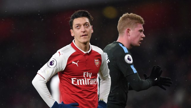 ​LEADER: Kevin De Bruyne riles the troops behind Arsenal's Mesut Ozil during the second half.