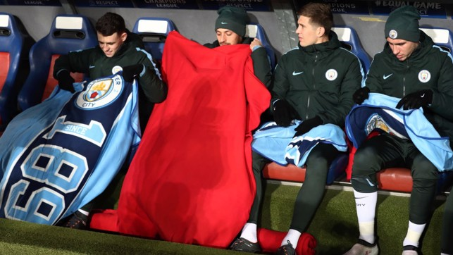CHILLY: City's subs try to keep warm on a freezing night in Switzerland.