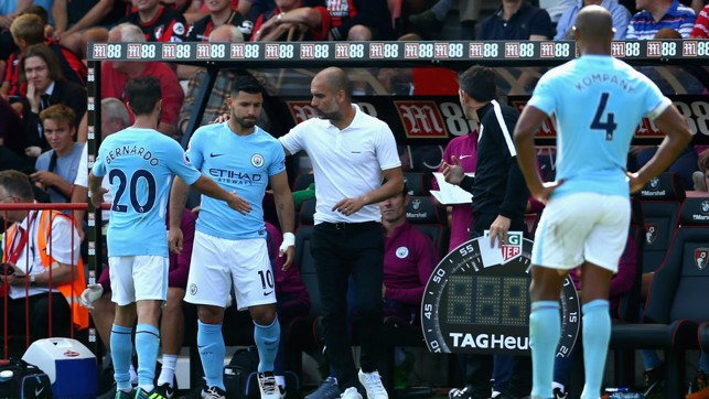 'PEP'T AND READY: The boss gives instructions to Aguero as he prepares to come on.