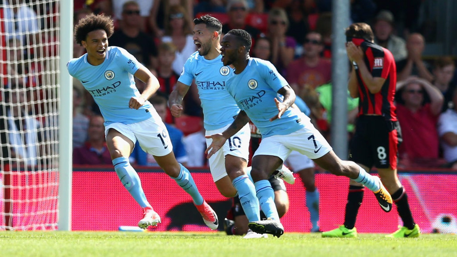 PURE JOY: Sterling rushes over to the travelling supporters as he snatches all three points in the final minute.