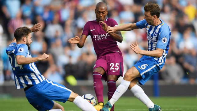 FERNANDINHO SANDWICH: Two Brighton midfielders surround the Brazilian.