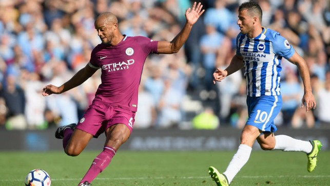 CLEARANCE: Vincent Kompany goes long under pressure from Tomer Hemed.
