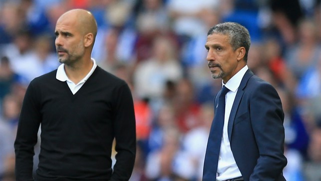 THE BOSS: Pep watches on alongside Brighton manager Chris Hughton.