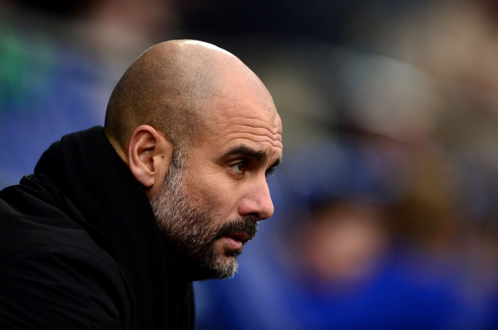 PENSIVE: Pep Guardiola looks on from the bench at the Cardiff City Stadium.