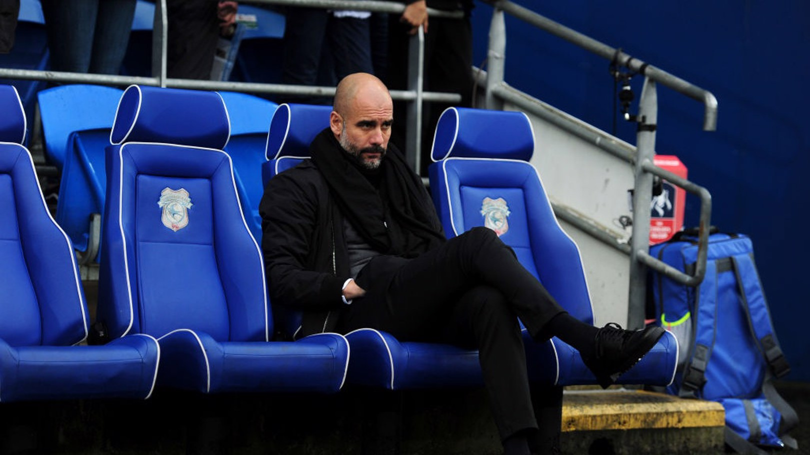 PEP WATCH: The manager takes his seat at the Cardiff City Stadium.