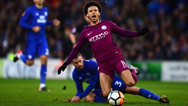 SORE: Leroy Sané on the receiving end of a nasty challenge.