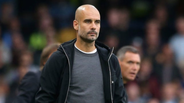 EYES ON THE PRIZE: City boss Pep Guardiola looks on
