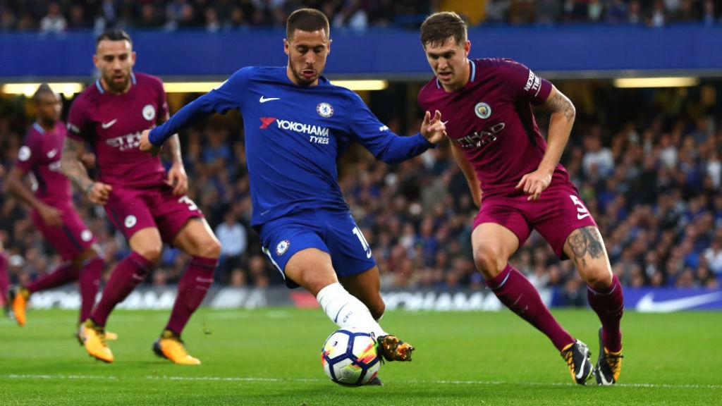 NO ENTRY John Stones keeps a watchful eye on Eden Hazard