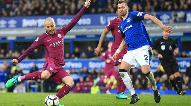 PROBING: David Silva looks for a fourth City goal.