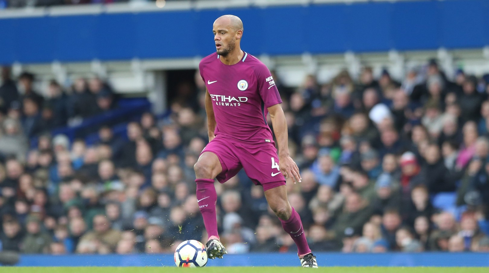 LEADER: Vincent Kompany on the ball.