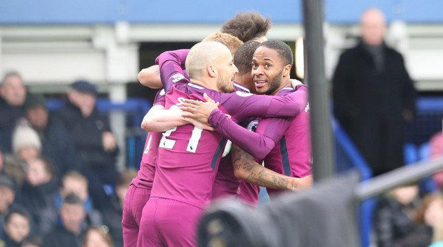 RAMPANT: City celebrate Raheem Sterling's 21st goal of the season.